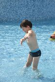 Little Boy Play Swimming And Playing In The Pool. Cheerful Child Play In The Swimming Pool poster