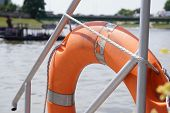 Lifebuoy Orange Hanging On The Side Of The Boat, Safety. Boating Or Boating On The River For Everyon poster
