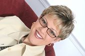 Business Woman In Beige Wearing Glasses poster