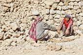 Kashmiri Rock Carriers Taking Chat Break