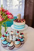 Interior Decoration For A Kids Child Birthday Is One Year Old. Festive Table With Cupcakes, Macaroon poster