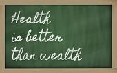 Expression -  Health Is Better Than Wealth - Written On A School Blackboard With Chalk