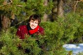 Young man smiling in winter forest