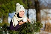 Young smiling woman drink tea in winter forest
