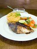 foto of yellowfin tuna  - fresh Caribbean style yellowfin tuna steak with vegetables rice as photographed in Union Island St - JPG