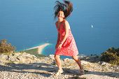 girl dancing on vidova gora on brac island, crotia