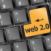 Web 2.0 computer key in yellow showing social medias