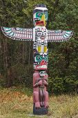 stock photo of indian totem pole  - Detail of a Native American Totem Pole - JPG