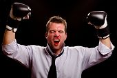 Victorious Boxing Businessman Wth Blood Pouring Out Of His Nose And Mouth