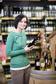 Young Woman Buying Wine