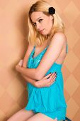 image of nightie  - Pretty blonde woman in a blue nightie - JPG