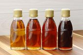 stock photo of maple syrup  - delicious maple syrup made in vermont and canada great over almost any food including the world famous pancakes waffles and also lots of baked goods - JPG