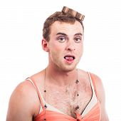 stock photo of transvestite  - Close up of transvestite man sticking out tongue isolated on white background - JPG