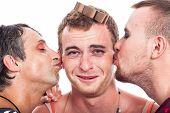 foto of transvestite  - Close up of funny transvestites kissing isolated on white background - JPG