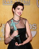 LOS ANGELES - JAN 27:  Anne Hathaway  in the press room at the 2013 Screen Actor's Guild Awards at t
