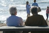 image of elderly couple  - a photo of an elderly couple on the beach - JPG