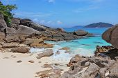 Similan Islands, Andaman Sea, Thailand.  Finest white sand beach adjacent to the great brown cliffs
