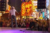 A Crowd Sings Along With A Band In Las Vegas, June 21, 2013.