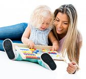 Mother teaching her daughter the abacus - isolated over white background
