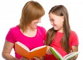 Happy mother and her daughter are reading books, isolated over white