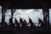 Silhouette of Women Practicing Yoga On Beach