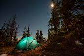 Tent Illuminated With Light In Night Forest