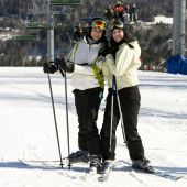 Two Sisters Skiing Together