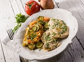 escalope with tomatoes and zucchinis