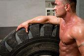 Bodybuilder Resting After Turning Tires
