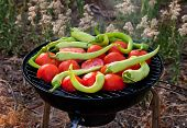 Tomato And Peppers Fish Grilling On Bbq