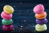 Macaroons On A Dark Black Wooden Background