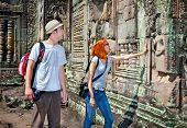 Beautiful young couple at  Angkor Wat temple complex, near Siem Reap, Cambodia.