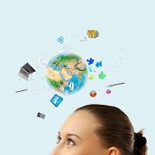 Half of face of businesswoman with business items above head. Elements of this image are furnished b