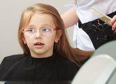 Hairdresser Combing Hair Little Girl Child In Hairdressing Beauty Salon