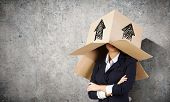 Funny businesswoman with carton box on head
