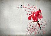 Football player in jump striking ball with sketches at backdrop