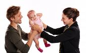 Business woman and mother handing child to stay at home father