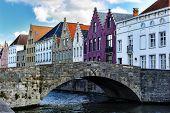 Medieval Bridge Over Canal In Bruges