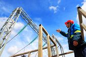 stock photo of substation  - The electrician examines the equipment of electric substation - JPG