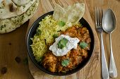 stock photo of curry chicken  - Jalfrezi Indian chicken curry with pilau rice and pappadoms - JPG