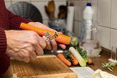 Male Hands Peel Vegetables