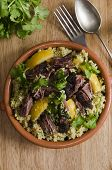 stock photo of tagine  - Traditional Moroccan beef tagine with couscous and preserved lemon - JPG