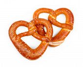 stock photo of pretzels  - Pair delicious Bavarian pretzel in heart shape isolated - JPG