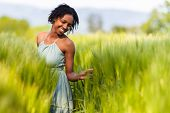 African American Woman In A Wheat Field - African People