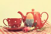 stock photo of bed breakfast  - Retro vintage red check Happy Mothers Day breakfast in bed with tea cup tea pot and egg in red and blue polka dot 1950s style china - JPG