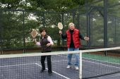 Man And Woman Playing Paddle Platform Tennis