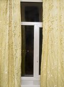 Window With Yellow Curtains