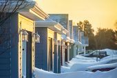 picture of blanket snow  - Sunrise on a neighborhood blanketed in snow - JPG