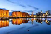 stock photo of descriptive  - Liverpool waterfront skyline with its famous buildings like Pierhead albert dock salt house ferry terminal etc - JPG
