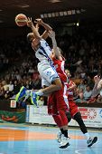 KAPOSVAR, HUNGARY - MARCH 8: Louis Hinnant (white 4) in action at a Hungarian Championship basketbal
